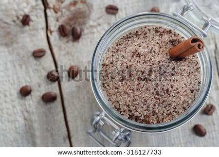 Homemade scrub made of sugar, ground coffee and cinnamon powder (top view)