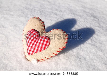 Homemade sewn heart on snow background #94366885