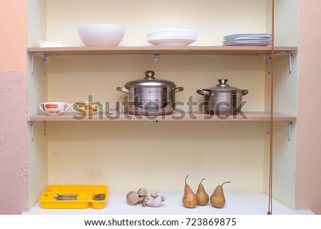 homemade shelves in a niche in a village house