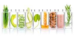 Homemade skin care with natural ingredients wheat grass ,avocado ,aloe vera ,cucumber ,himalayan salt  ,honeycomb ,almonds, centella asiatica and rosemary  in glass bottles isolate on white background