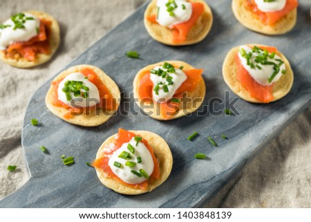 Homemade Smoked Salmon Cocktail Blinis with Creme and Chives Stock photo ©