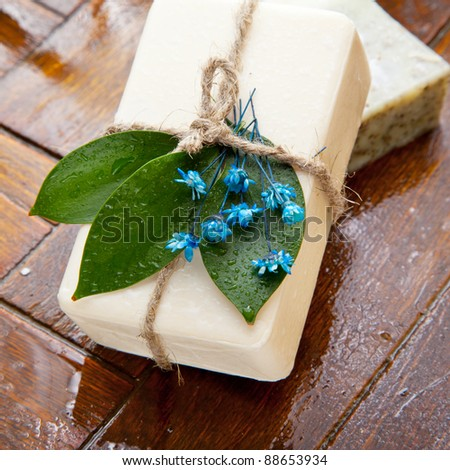 Homemade soap with blue lavender flowers on the floor