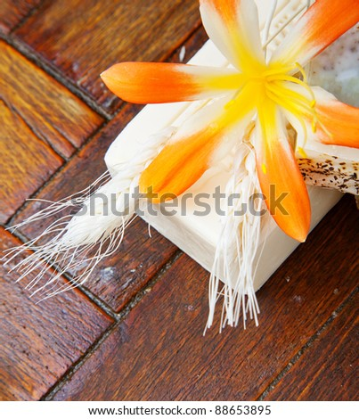 Homemade soap with yellow flower on the floor