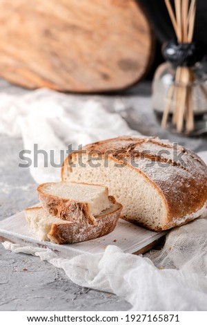 Homemade sourdough bread on rustic background