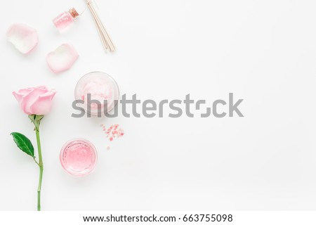 homemade spa with rose cosmetic set, cream, salt and oil on white background top view mock-up #663755098