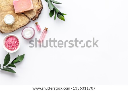 homemade spa with woman cosmetics on white background top view copyspace