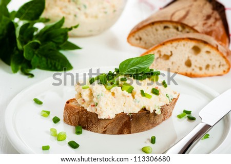 Homemade spicy cheese with bread on a white wood table