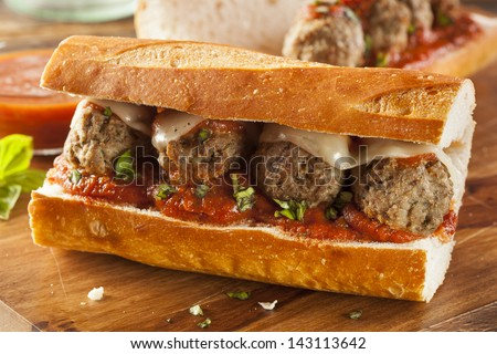 Homemade Spicy Meatball Sub Sandwich with Marinara Sauce and Cheese