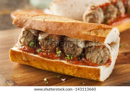Homemade Spicy Meatball Sub Sandwich With Marinara Sauce And Cheese