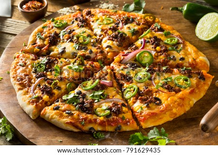 Stock Photo Homemade Spicy Mexican Taco PIzza with Cilantro and Chorizo