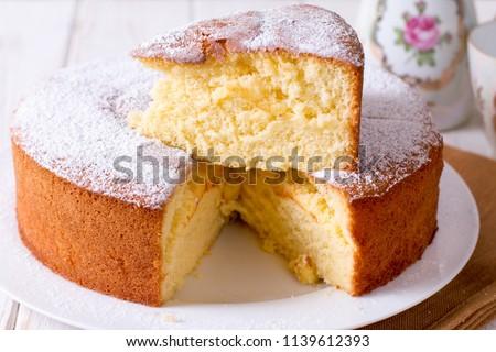 Homemade sponge cake on a white wooden table