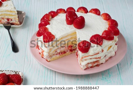 homemade strawberry cake cut. Strawberry pie decorated with fresh strawberries stands on a plate. Ice cream and strawberry cream. Cut off a piece. High quality photo