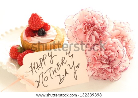 homemade strawberry cup cake with elegant carnation flower for mother's day image