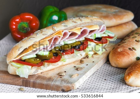 Homemade Sub Sandwich with ham, cheese and vegetables