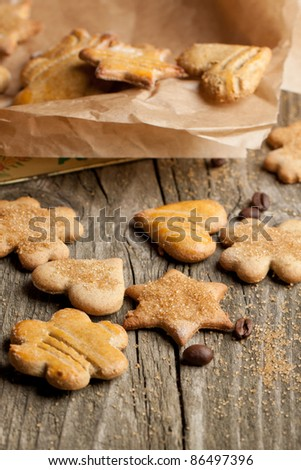 Homemade sugar cookies with coffee beans on old wooden table