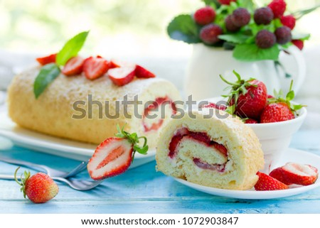 Homemade swiss roll biscuit cake with fresh strawberries