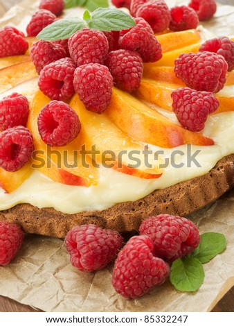 Homemade tart with nectarine, raspberries and custard. Shallow dof.