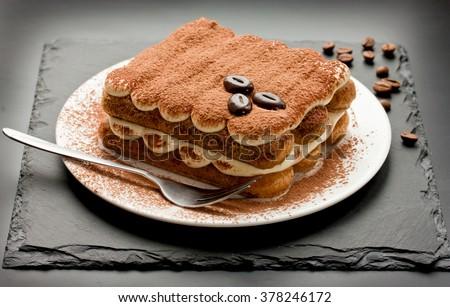 Homemade tiramisu cake traditional Italian dessert toning selective focus