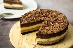 Homemade triple layers chocolate bake cheesecake in round shape