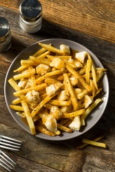 Homemade Unhealthy Canadian Poutine French Fries with Gravy and Cheese Curds