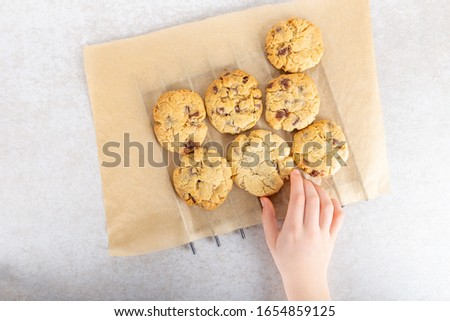 Homemade vanilla biscuits with chocolate chips made by kids