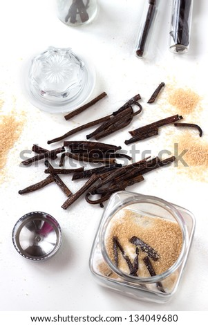 Homemade vanilla white and brown sugar in a glass jar with vanilla sticks