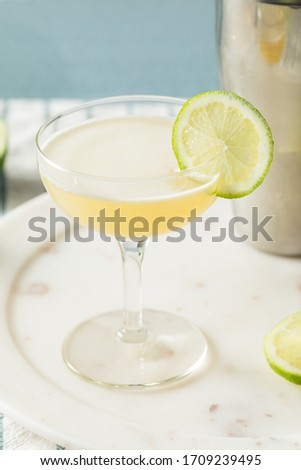 Homemade Vokda Gimlet Cocktail in a Coupe Glass Photo stock ©
