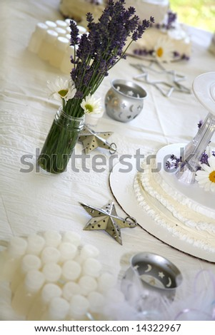 stock photo Homemade Wedding Cake with Fresh Daisies and Lavender