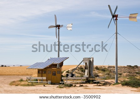 homemade wind and solar energy sources at an alternative energy farm using recycled materials