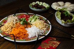 Homemade Yee Sang - Chinese New Year Prosperity Toss. Consist of raw fish mixed with shredded vegetables and a variety of sauces and condiments