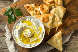 Homemade Yogurt Labneh Cheese Dip with Olive Oil and Pita