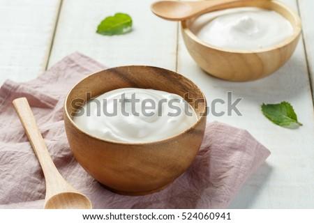 Homemade yogurt or sour cream in a wooden bowl, Health food from yogurt concept Stock fotó ©