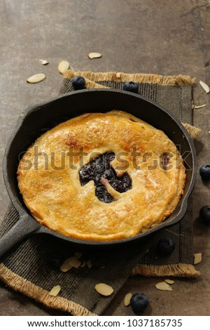 HomemadeSkillet baked  Blueberry Pie with cut out Pi  day writing top down view