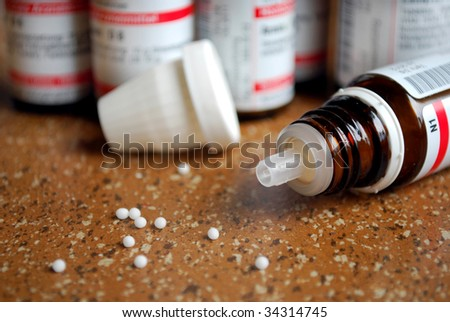 homeopathic globule with bottles in background