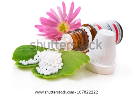 Homeopathic medication with coneflower globules. Alternative medicine concept