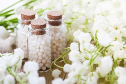 homeopathic pills on color background