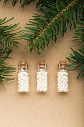 Homeopathic pills with pine tree on cork background. Homeopathy, naturopathy and alternative medicine