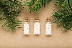 Homeopathy border background, globules in bottles and pine on 