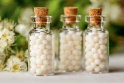 Homeopathy globules in bottles. homeopathy, naturopathy and alternative medicine. Alternative homeopathy medicine concept.