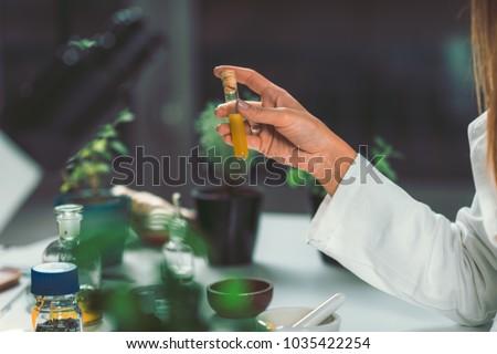 Homeopathy lab. Homeopath preparing alternative herbal medicines. Stock photo ©