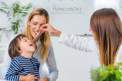 Homeopathy. Mother and little boy visiting a homeopath