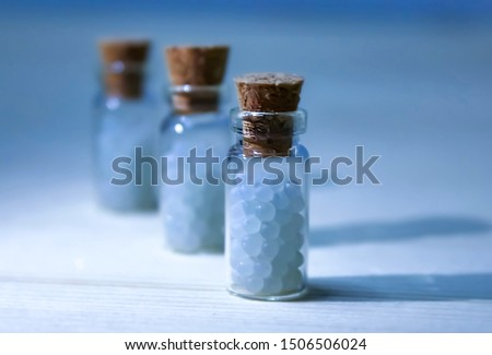 Homeopathy pills in vintage bottles on white background. A bottle of homeopathic remedies	 #1506506024