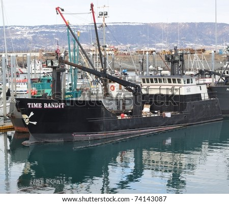 "HOMER, AK - MARCH 27: The Time Bandit commercial fishing boat from Discovery Channel's ""Deadliest Catch"" series docked in the harbor in Homer Alaska on March 27, 2011."