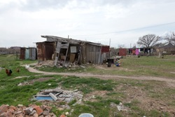 Homes in poor neighborhood where poor people live. Destruction of old houses, earthquakes, economic crisis, abandoned houses. Living in broken, unusable house is poor quarter. Odessa, Ukraine, 2019