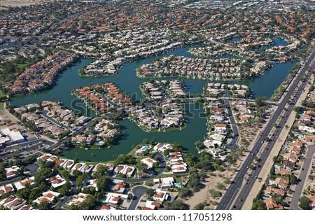 Homes on man made lake in suburban Scottsdale, Arizona