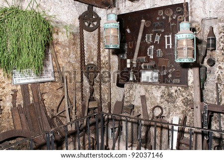 HOMESTEAD, FL - CIRCA APRIL 2010: The hand tools used to build the mysterious Coral Castle Circa April 2010 in Homestead, FL.  The builder took his secrets with him to the grave.