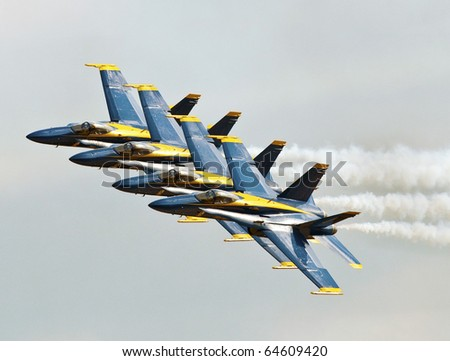 """HOMESTEAD, FL - NOVEMBER 6 : """"Blue Angel Jets"""" fly in formation over Homestead Air Force Base on """"Wings over Homestead"""" Air Demonstration Nov 6, 2010 in Homestead, FL"""