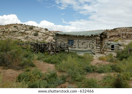 homestead in the desert log cabin and wagon