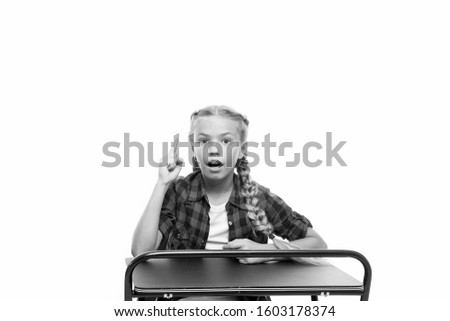 Homework idea. Little girl keeping finger raised isolated on white. Adorable small child reciting homework in class. Doing homework assignment. Homework supervision.