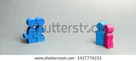 Homosexual and heterosexual couple. Homophobia. Tolerance for non-traditional sexual orientations in society. Legalization of marriage unconventional couples. Wooden figures #1427776232